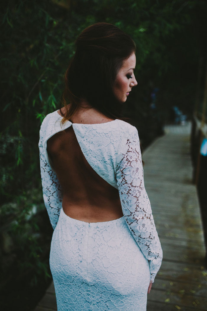 bride in backless wedding dress
