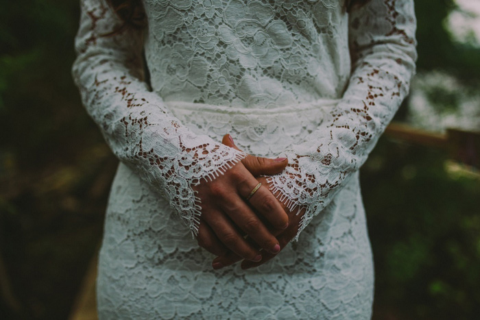 bride with hands clasped in front of her