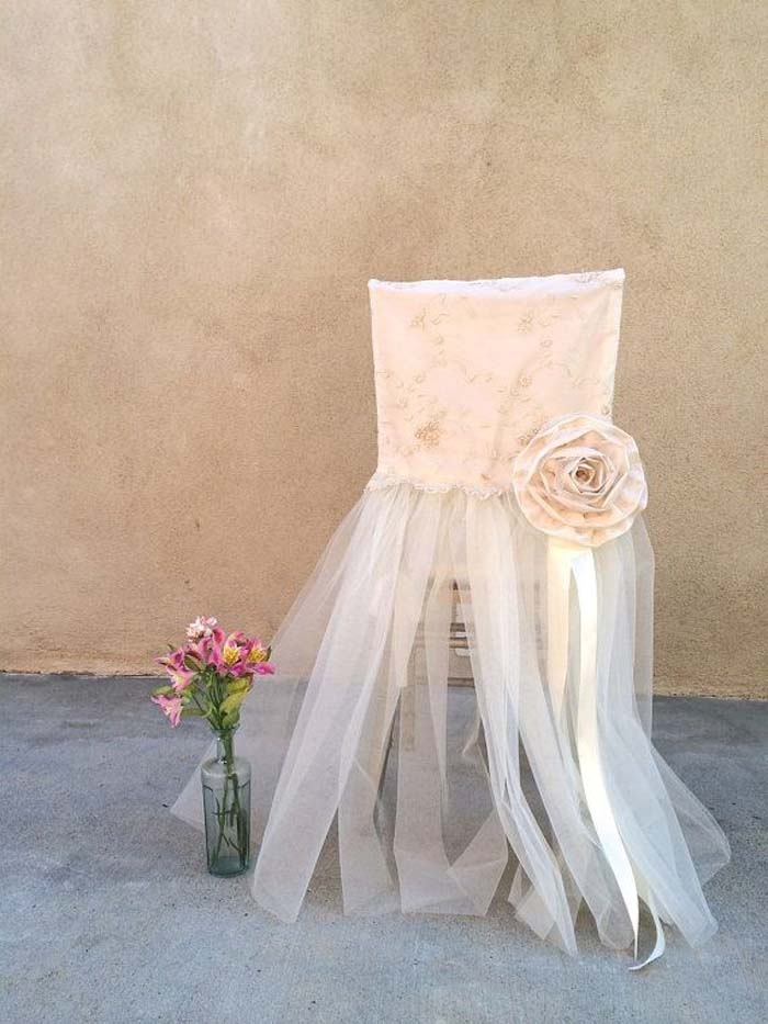 http://www.intimateweddings.com/wp-content/uploads/2015/11/Pink-Flower-Chair-Cover-700x933.jpg