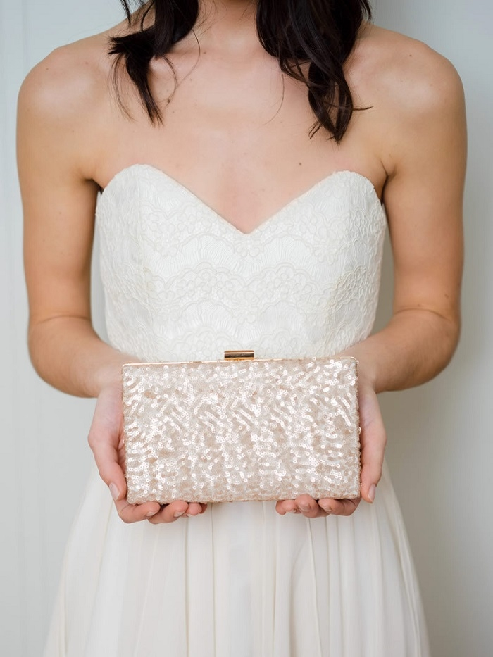 http://www.intimateweddings.com/wp-content/uploads/2016/02/Blush-Sequin-Box-Clutch-700x933.jpg