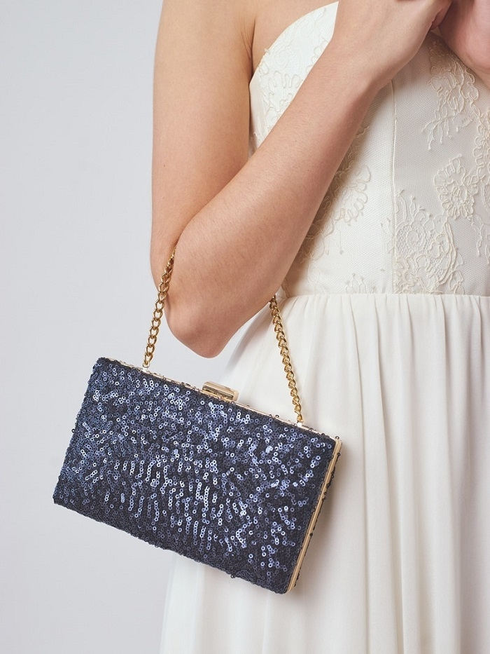 http://www.intimateweddings.com/wp-content/uploads/2016/02/Navy-Sparkle-Clutch-700x933.jpg