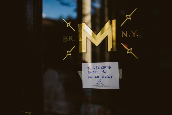 Martha restaurant door sign