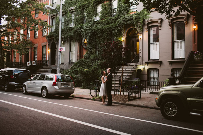 Bride and groom dancing in the street