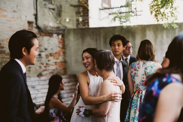 bride hugging her mom at reception
