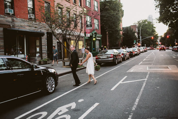 bride and groom crossing the street