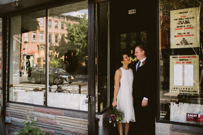 bride and groom in doorway of restaurant