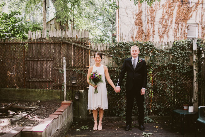 bride and groom portrait in backyard