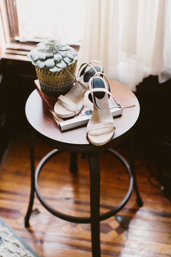bride's shoes on end table