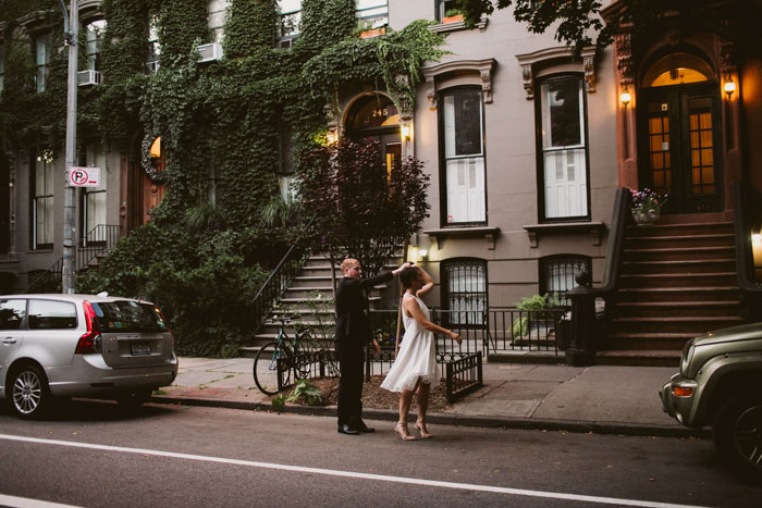bride and groom dancing on brooklyn sidewalk
