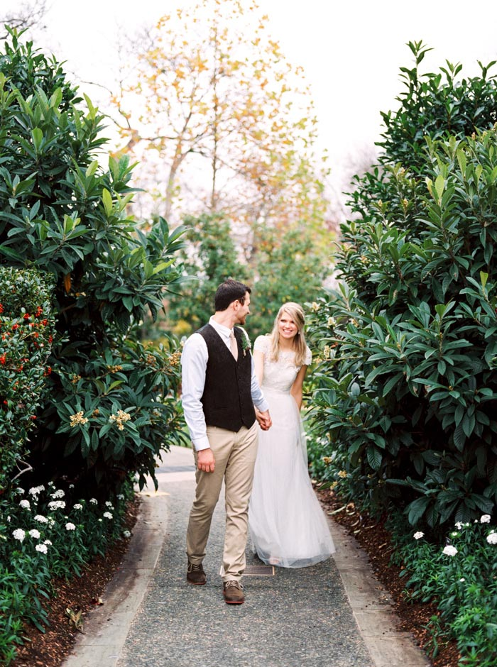 bride and groom walking down garden path