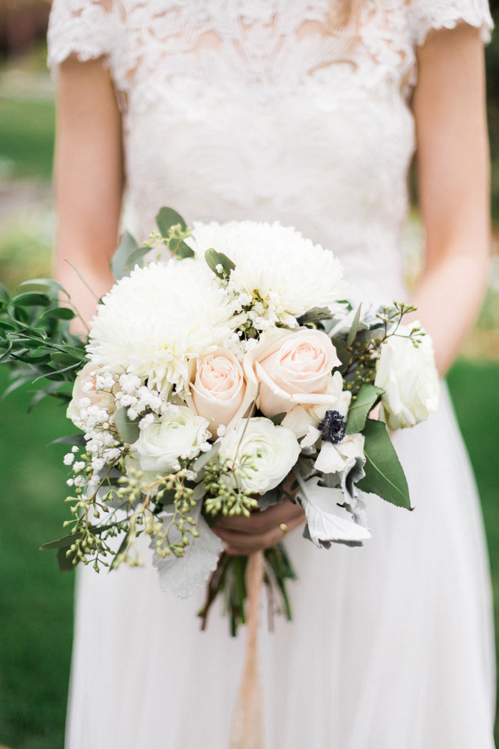 bride holding white and pink wedding bouquet