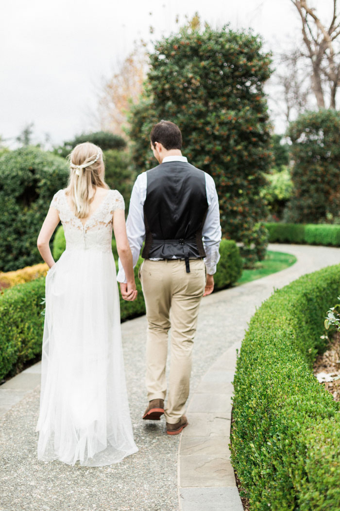 bride and groom walking down path