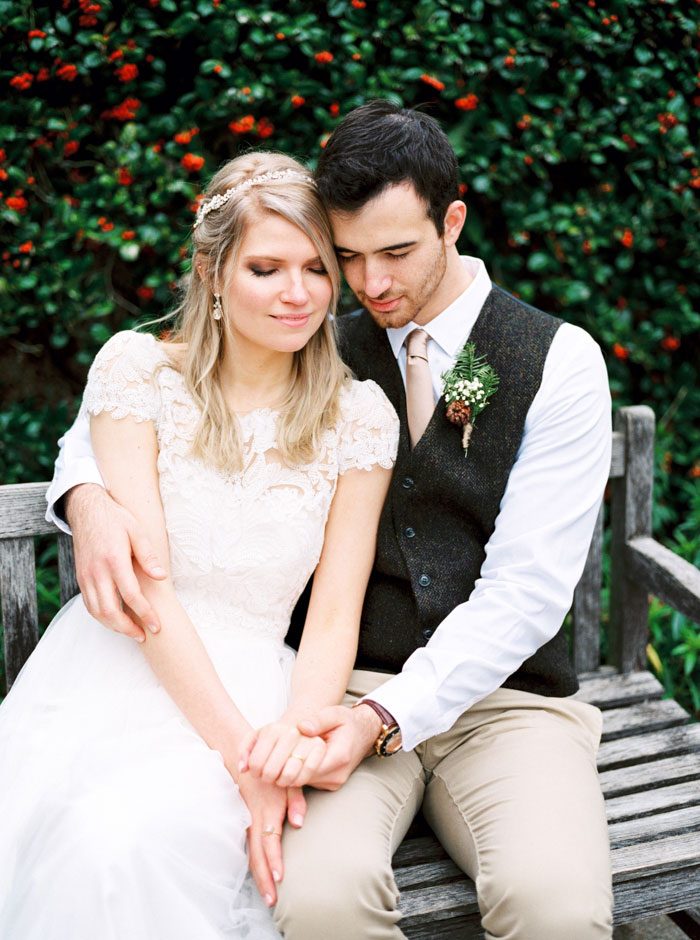 bride and groom portrait on bench