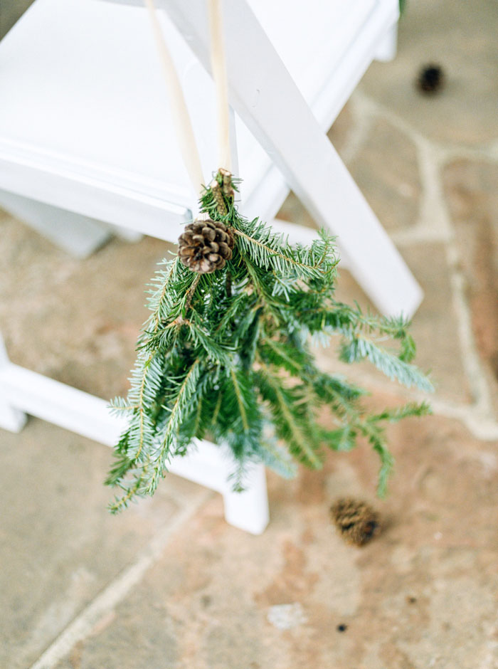 pinecone and swag ceremony chair decor