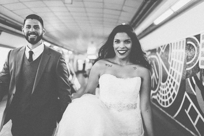 bride and groom in subway station