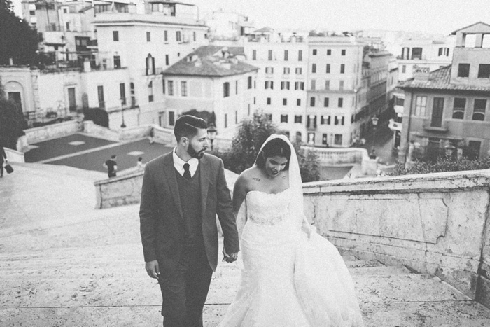 bride and groom climbing steps in Rome