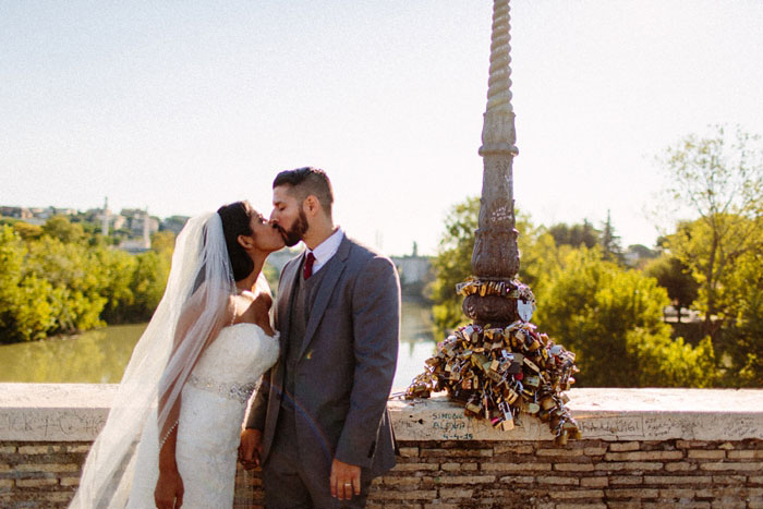 bride and groom kissing at outdoor elopement ceremony in Rome