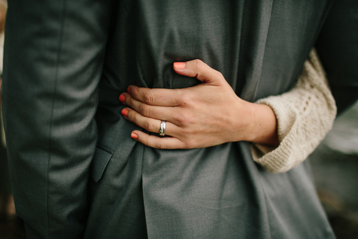 bride's hand on groom's back