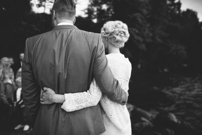bride and groom with arms around each other's waists