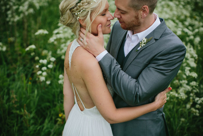 groom with hand on bride's cheek