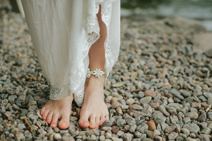 bride's feet on rocky beach