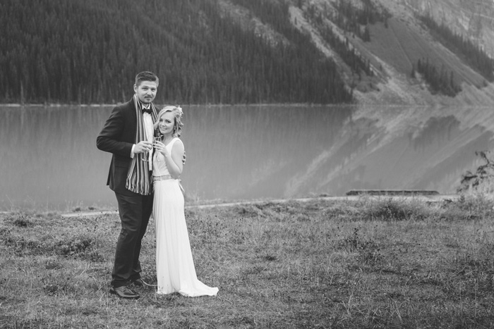 black and white bride and groom portrait in front of Lake Louise
