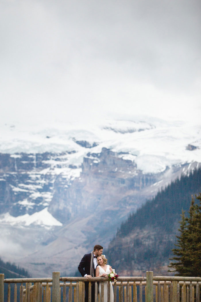 bride and groom portrait in front of mountains
