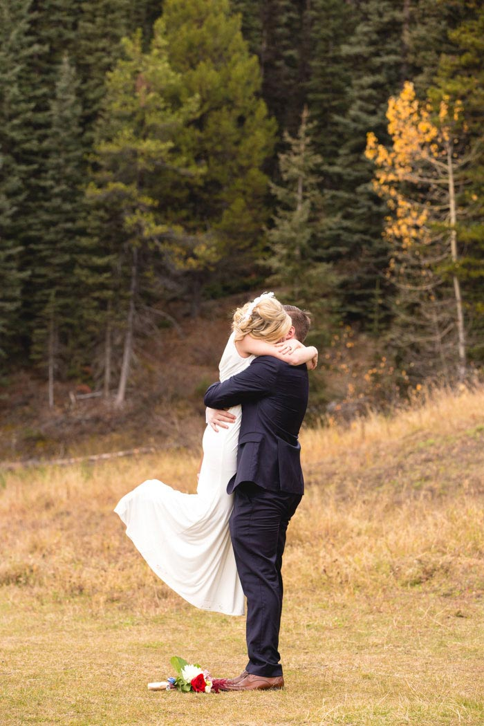 bride and groom hugging after elopement ceremony
