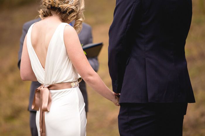 bride and groom holding hands during elopement ceremony