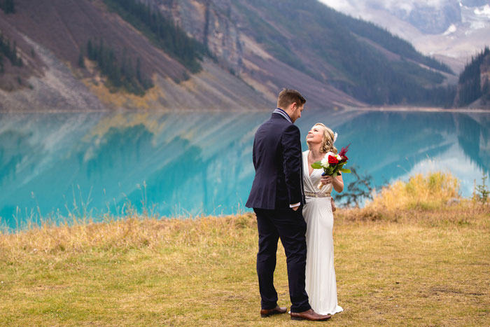 bride and groom in front of Lake Louise