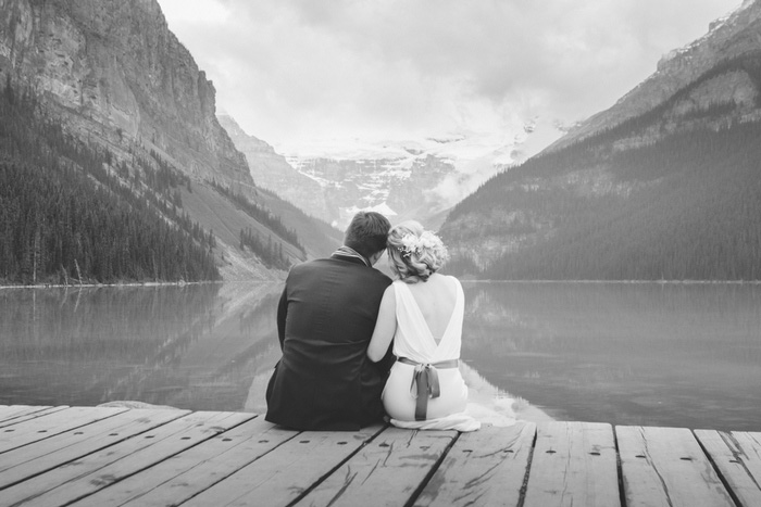 black and white bride and groom portrait at Lake Louise