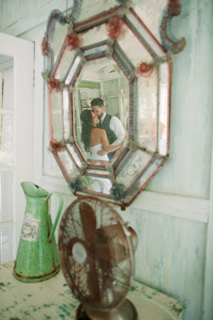 bride and groom refelction in mirror