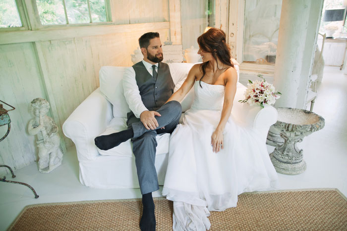 bride and groom sitting oncouch