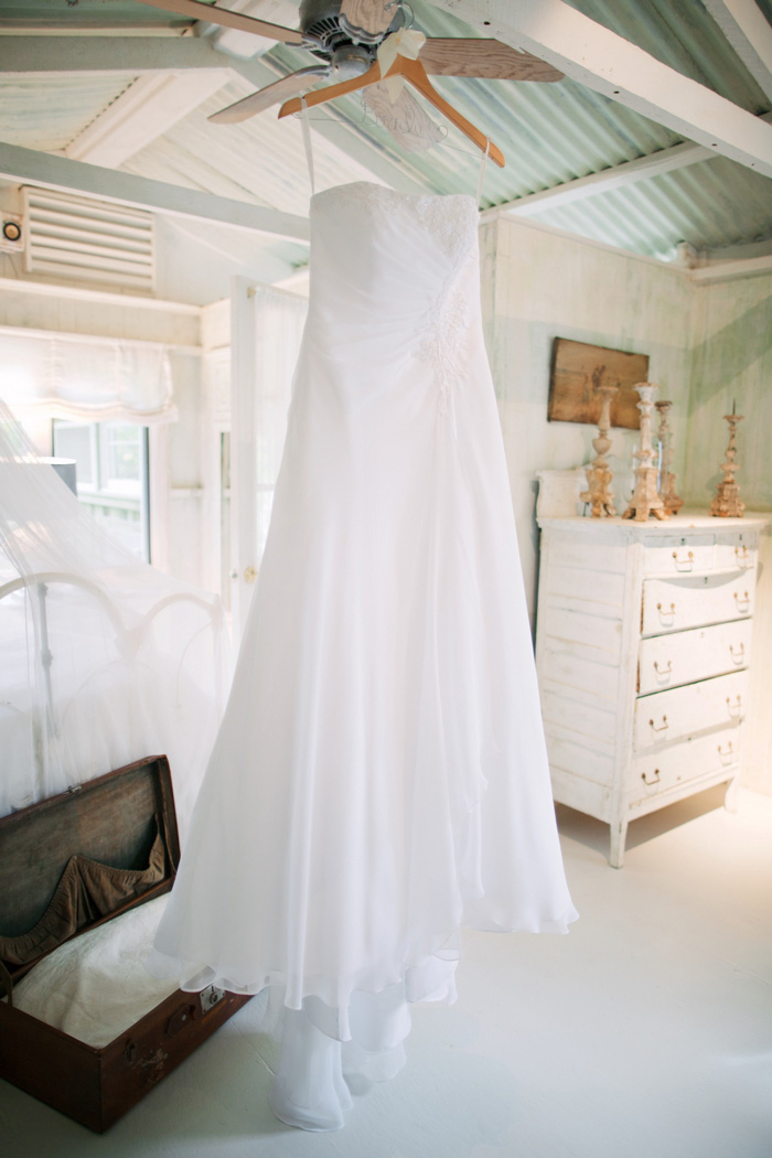 wedding dress hanging up in cottage