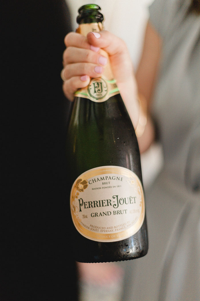 bridesmaid holding champagne