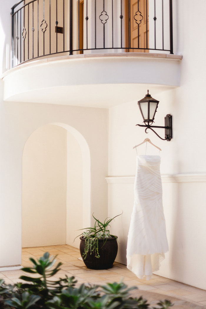 wedding dress hanging on light