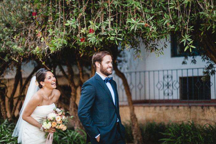 bride coming up behind groom