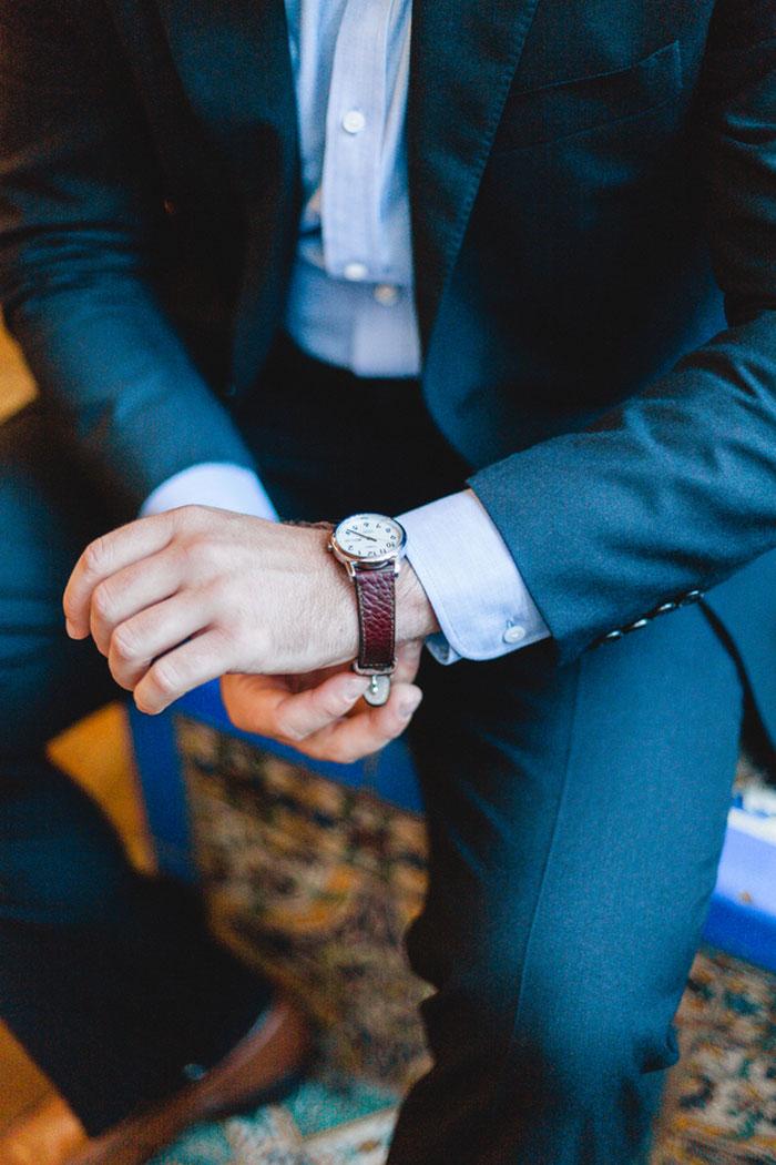 groom adjusting watch