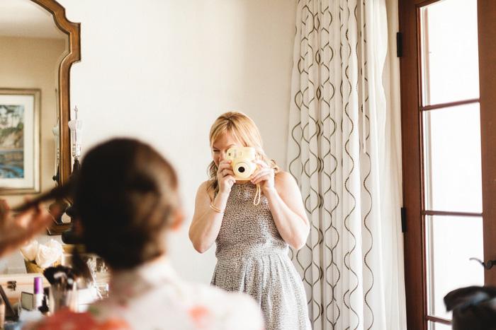 bridesmaid photographing bride
