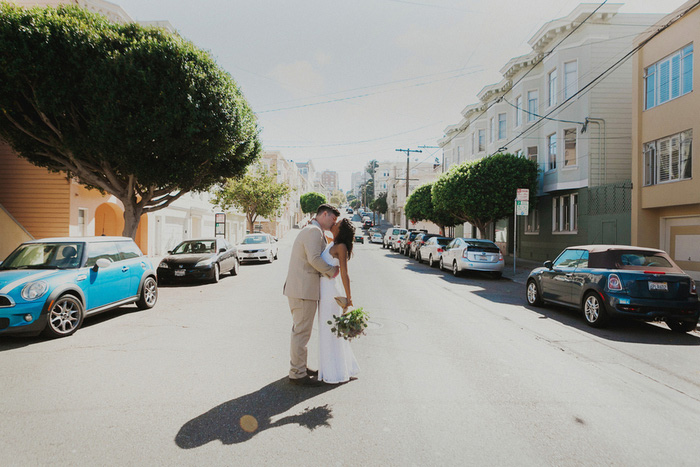 bride and groom kissing in San Francisco street