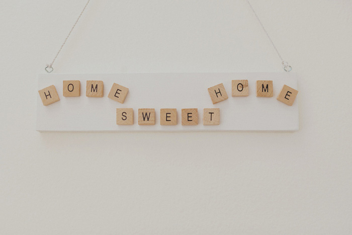 home sweet home sign with scrabble tiles