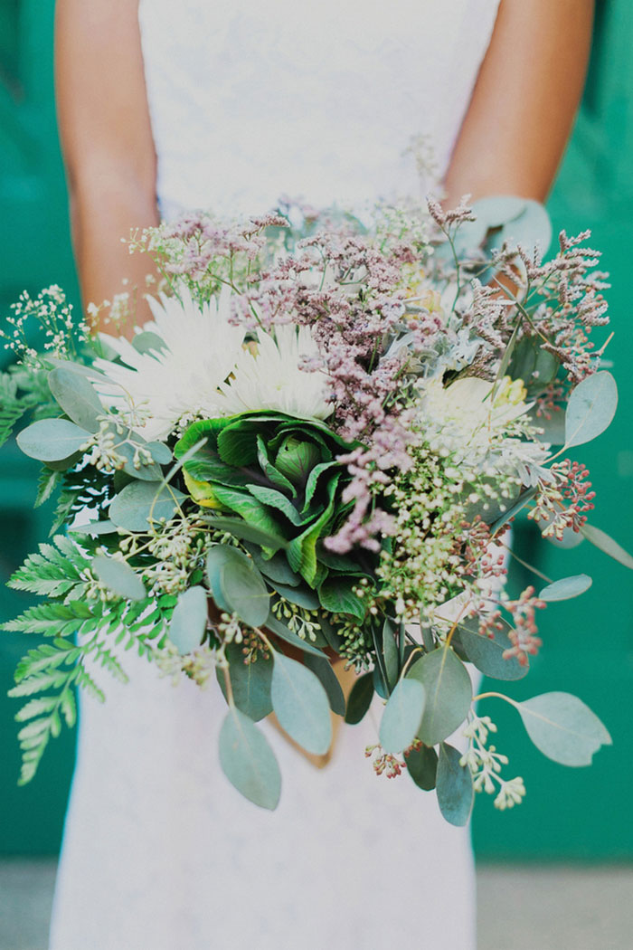 bride holding lush wedding bouquet