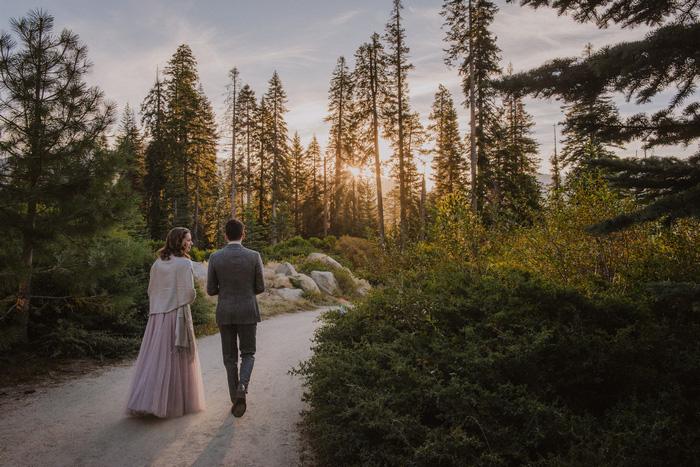 bride and groom walking along path