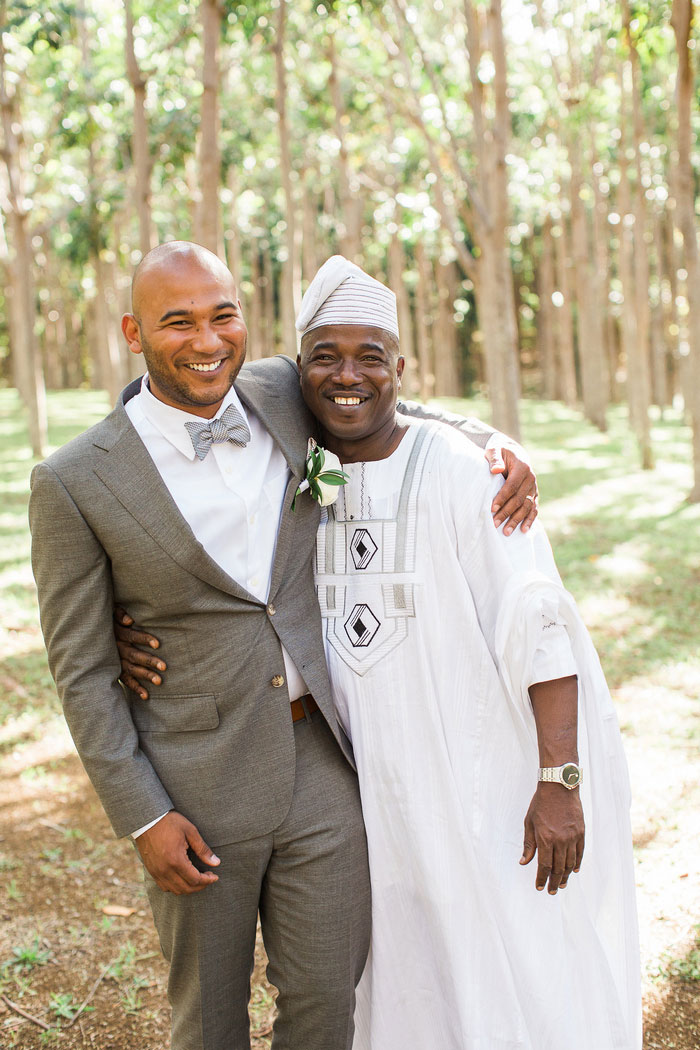 groom portrait with officiant
