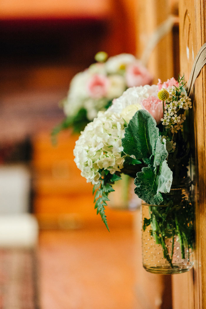 flowers on church pews