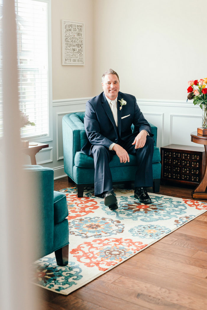 groom sitting in chair