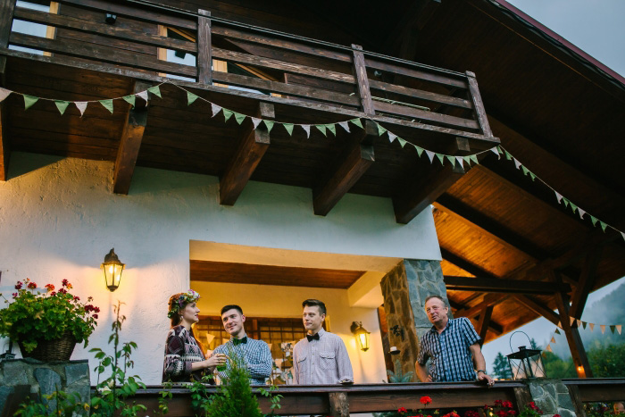 bride and guests on chalet porch