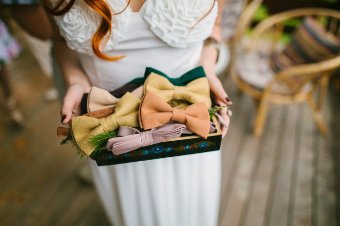 bride holding box of bow ties