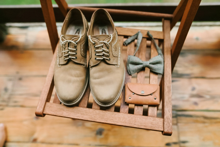 groom's accessories on a chair