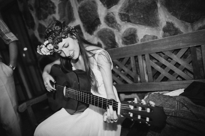 bride playing guitar